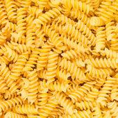Italian Fusilli, Rotini or Scroodle Macaroni Pasta food background texture — Stock Photo