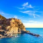 Manarola village, rocks and sea at sunset. Cinque Terre, Italy — Stock Photo #22239799