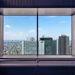 Aerial view of Shinjuku skyscrapers through a window frame. Tokyo, Japan. — Stock Photo