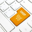 Shop business concept. Orange shopping cart button or key on white keyboard — Stock Photo #22594205