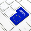 Europe web concept. blue and star flag enter button or key on white keyboard — Stock Photo #22657223