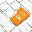 Blog business concept, text and icon. Orange button or key on white keyboard — Stock Photo