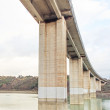 Concrete road viaduct or bridge architecture. Bottom view. - Stock Photo