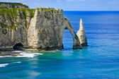 Etretat Aval cliff and rocks landmark and blue ocean . Normandy, France. — Stock Photo
