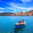 Stock Photo: Wooden small boat in Porto Santo Stefano seafront. Argentario, Tuscany, Italy