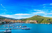 Porto Ercole village and harbor in a sea bay. Aerial view, Argen — Stock Photo