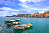 Wooden small boats in Porto Santo Stefano seafront. Argentario, Tuscany, Italy — Stock Photo