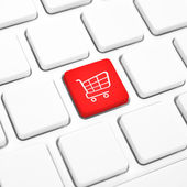 Shop online business concept. Red shopping cart button or key on keyboard — Stock Photo