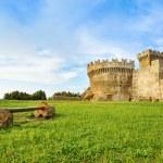 Populonia medieval village landmark, bench, city walls and tower. Tuscany, Italy. — Stock Photo