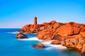 Ploumanach lighthouse sunset in pink granite coast, Brittany, Fr — Stock Photo