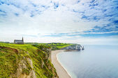Etretat, ocean, church and Aval cliff landmark. Normandy, France. — Stock Photo