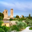 San Gimignano landmark medieval town on sunset, towers and park. Tuscany, Italy — Стоковая фотография