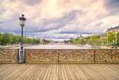 Love padlocks on Pont des Arts bridge, Seine river in Paris, France. — Stock Photo