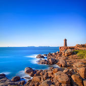 Ploumanach lighthouse sunset in pink granite coast, Brittany, France. — Stock Photo