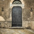 Traditional old vintage iron door in Tuscany, Italy. — Stock Photo