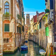 Stock Photo: Venice cityscape, water canal, campanile church and traditional buildings. Italy