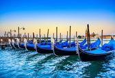 Venice, gondolas or gondole on sunset and church on background. Italy — Stock Photo