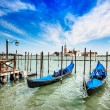 Stock Photo: Venice, gondolas or gondole and church on background. Italy