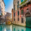Stock Photo: Venice cityscape, water canal, bridge and traditional buildings. Italy