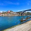Oporto or Porto skyline, Douro river, boats and iron bridge. Portugal, Europe. — Stock Photo #30233035