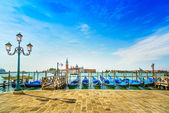 Venice, street lamp and gondolas or gondole and church on background. Italy — Stock Photo