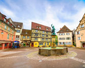 Colmar, Petit Venice, fountain, square and traditional houses. Alsace, France. — Stock Photo