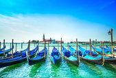 Venice, gondolas or gondole and church on background. Italy — Stock Photo