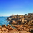 Stock Photo: Ploumanach lighthouse morning in pink granite coast, Brittany, France.