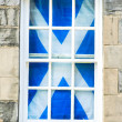 Scottish flag in a traditional white window. Scotland. — Stock Photo