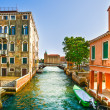 Venice cityscape, boats, water canal, bridge and traditional bui — Stock Photo #33381189