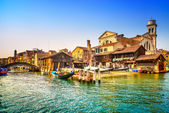 Venice, water canal, bridge and gondolas or gondole depot. Italy — Stock Photo
