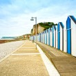 Yport and Fecamp, Normandy. Beach huts or cabins and cliffs. France. — Stock Photo
