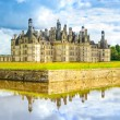 Chateau de Chambord, Unesco medieval french castle and reflection. Loire, France — Stock Photo #34846853