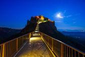 Civita di Bagnoregio landmark, bridge view on twilight. Italy — Stock Photo