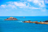 Brittany ocean panorama, islands and lighthouse Point du Grouin. — Stock Photo