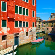 Venice cityscape, water canal, boats and traditional buildings. — Stock Photo