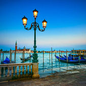 Venice, street lamp and gondolas or gondole on sunset and church — Foto Stock