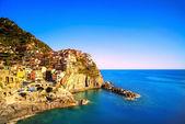 Manarola village, rocks and sea at sunset. Cinque Terre, Italy — Stock Photo