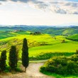 Tuscany, rural sunset landscape. Countryside farm, white road an — Stock Photo