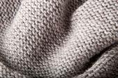 Achtergrond van grijze tricotstoffen — Stockfoto
