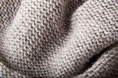 Background of gray knitted fabrics — Stock fotografie