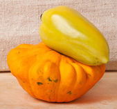 Peppers and squash on a wooden background — Stok fotoğraf