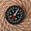 Compass on the background of the rope — Stock Photo #15723937