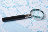 Magnifying glass on the map background — Stock Photo