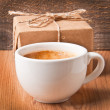 Cup of coffee and a gift — Stock Photo