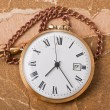 Old pocket watch on vintage paper — Stock Photo #22357029