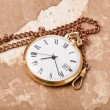 Old pocket watch on vintage paper — Stock Photo