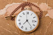 Old pocket watch on vintage paper — Stock fotografie