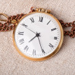 Old pocket watch on vintage paper — Stock Photo #22440295