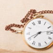 Old pocket watch on vintage paper — Stock Photo #22707681